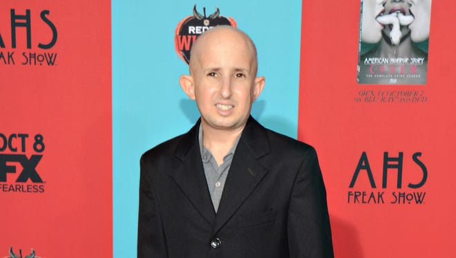 """Ben Woolf arrives at the premiere screening of """"American Horror Story: Freak Show"""" at TCL Chinese Theatre, in Los Angeles, California on Oct. 5, 2014.  Woolf, an actor on """"American Horror Story,"""" died Monday afternoon, Feb. 23, 2015, at Cedars-Sinai Medical Center in Los Angeles, publicist Zack Teperman said."""