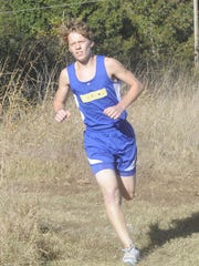Mountain Home's Abe Crawford runs at the Bomber Invitational on Tuesday.