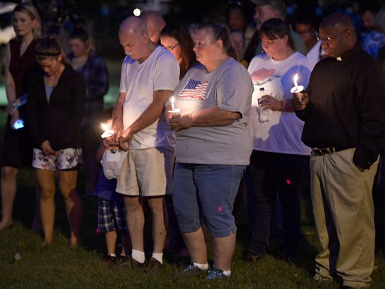 The community comes together during a vigil at Burnette