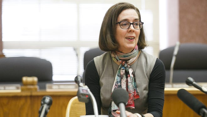 Gov. Kate Brown has ordered a statewide hiring freeze.