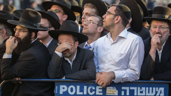 Ultra-Orthodox Jews mourn victims of Tuesday's savage rampage in the Har Nof neighborhood in Jerusalem.
