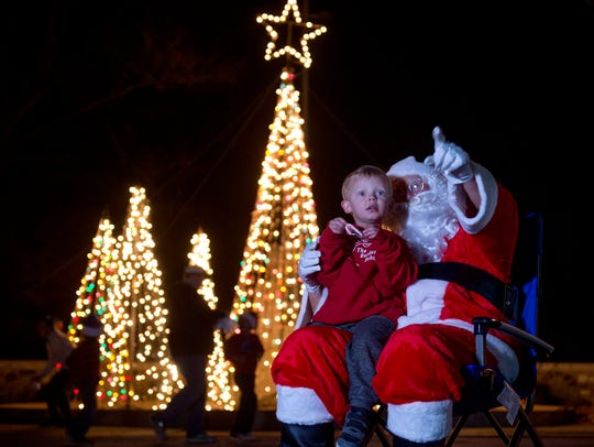 """Cody Russ, 3, looks as Bob """"Santa"""" Guess points out"""
