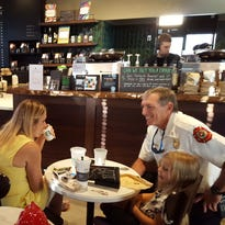 """Fire-Rescue Chief Michael Murphy chats with Marco Island residents during Friday's """"Coffee with the Chiefs"""" event at Starbucks."""
