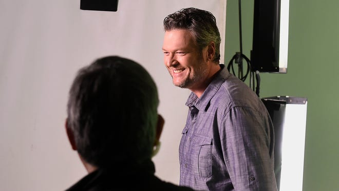 "Blake Shelton takes promotional videos in front of a green screen during a break in filming the ""The Voice"" on Jan. 16, 2017, in Los Angeles."