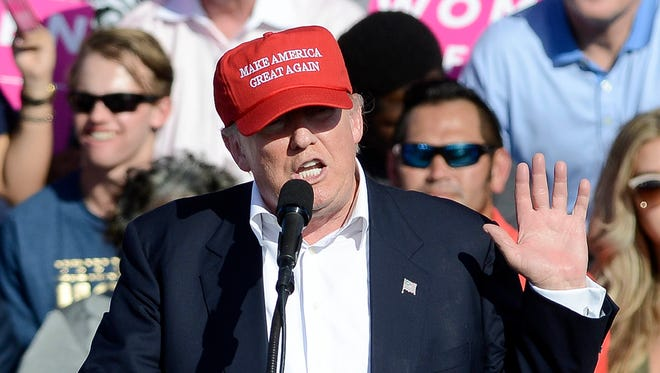 FILE- Donald Trump speaks at  the Central Florida Fairgrounds in Orlando, November 2, 2016.