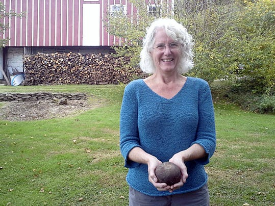 Ellen Shultz shows off the suspected cannonball her husband found in their barn in Spring Grove.