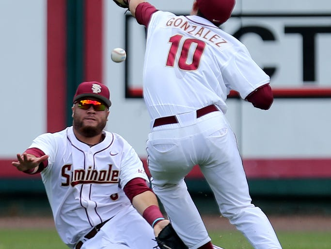 Justin Gonzalez (10) and DJ Stewart (8) miscommunicate on a fly ball as Florida State hosts the UCF Knights on fan appreciation day on Tuesday afternoon.