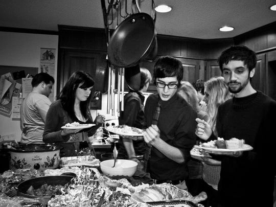 Dinner is served at Tyler Yoder's annual Friendsgiving party in Newark in 2011.
