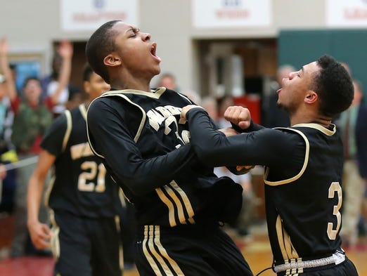 Warren Central player Djimon Henson, left, screams in celebration with teammate Devon Hawkins after making a last second three-point shot to win the game 47-44 in the Class 4A IHSAA Sectional #10 held at Lawrence North High School on Tuesday, March 4, 2014.