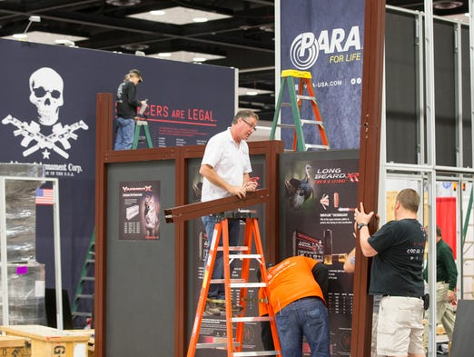 Workers put together a display in advance of the NRA's arrival this weekend at the Indiana Convention Center, Wednesday, April 23, 2014.