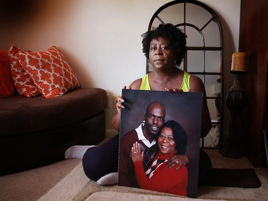 Debbie Long, wife of Mack Long, who was killed in an IMPD officer-involved shooting earlier this year, holds a photo of herself and her late husband in her Southside apartment.