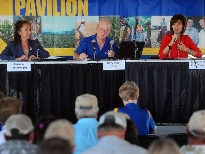 U.S. Rep. Kristi Noem (right) debates with candidate Corinna Robinson while Jerry Oster moderates during Dakotafest in Mitchell on Tuesday, Aug. 19, 2014.