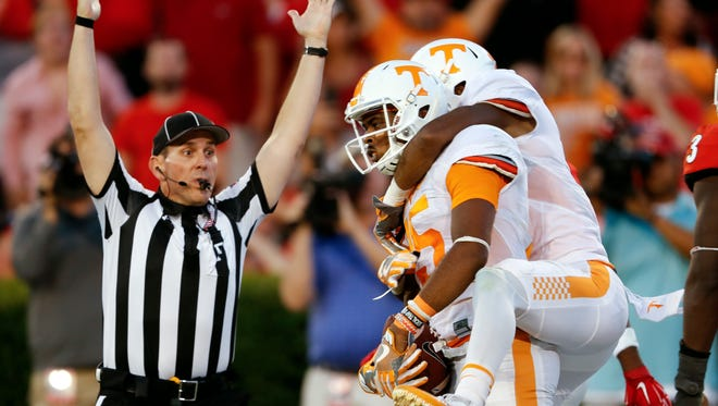 Tennessee wide receiver Jauan Jennings (15) celebrates with Tennessee wide receiver Josh Malone (3) after making a last-second touchdown catch to defeat Georgia 34-31 on Oct. 1, 2016.