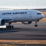 A Japan Airlines Boeing 777 lands at Tokyo's Haneda Airport on Jan. 28, 2016.