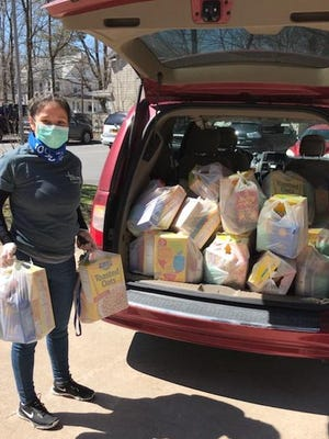 Eline Martinez, Case Manager at Catholic Charities of Orange, Sullivan, and Ulster's Kingston's office, delivered prepared bags of food to residents at the Ellenville Senior Housing Complex.