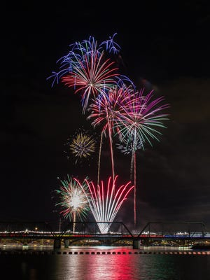 Edmundo Mendez Jr.  Fourth of July fireworks shine over Tempe Town Lake for a crowd of an estimated 50,000 people. Edmundo Mendez Jr. of Chandler had this view of the spectacle.