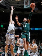 Michigan State's Miles Bridges shoots over Hillsdale's