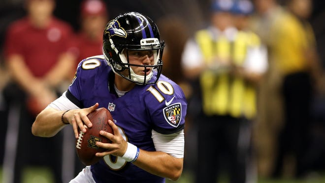 Keith Wenning looks to throw a pass against the Saints during a preseason game, Aug. 28, 2014.