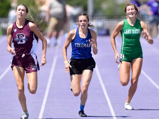 Shiean Walters of Coleman competes in the girls' 400 meters at Saturday's Region 1-3A Track and Field Championship at Abilene Christian University. Walters came in second, with  Kamryn Cantwell of Bowie (left) first and Jayden Fiebiger of Wall (right) third.