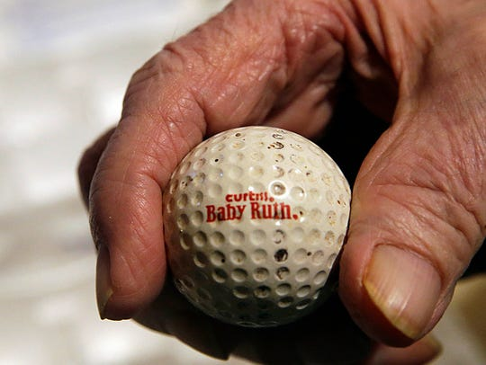 This is Don Thompson's first ball, a 50th-anniversary tribute to the Baby Ruth candy bar. Thompson retired 31 years ago and began collecting golf balls with logos on them. He now has more than 15,000 different ones on display racks in his basement in Franklin.