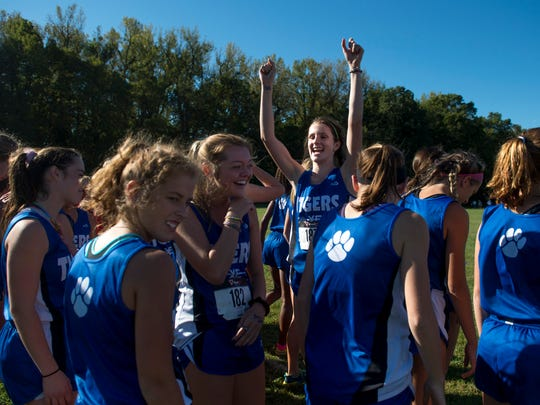 Memorial's Claire Sievern cheers to her teammates before the girls varsity race during the SIAC cross country meet at Angel Mounds in Evansville, Ind., on Saturday, Sept. 30, 2017. Sievern finished 8th with a time of 20:13.