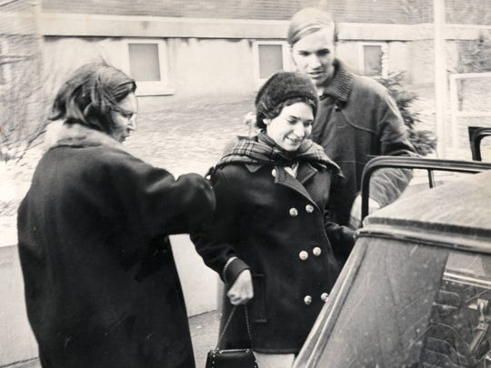 DeCourcy Squire, center, the 18-year-old antiwar demonstrator from Antioch College, refused to eat solid food from the time of her imprisonment Dec. 8, 1967 until her release Feb. 10, 1968. She is shown her with her mother, Lurline Squire of Morgantown, W. Va., on the day on her release.