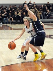 Genoa junior Carly Gose (#2) attempts to get by Woodmore's