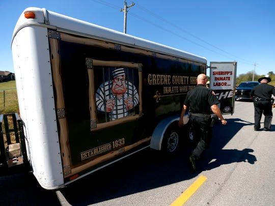 A sheriffs deputy walks past the inmate work for trailer on Farm Road 115 on Tuesday, Sept. 27, 2016.