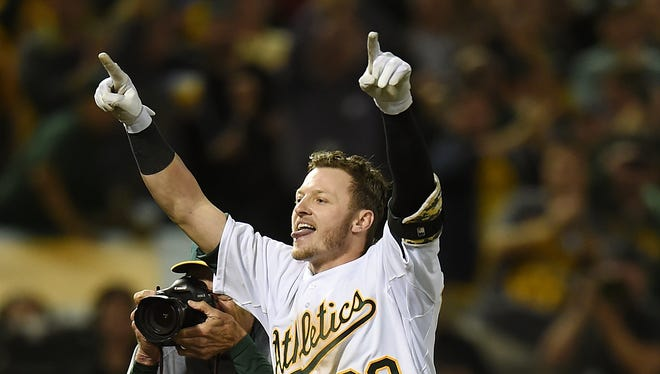 Josh Donaldson celebrates rounding the bases after hitting a three-run walk-off homer to defeat the Tigers.
