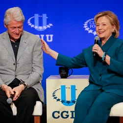 In this March 22, 2014, file photo, former President Bill Clinton, left, listens as former Secretary of State Hillary Rodham Clinton speaks during a student conference for the Clinton Global Initiative University at Arizona State University in Tempe, Ariz. Clinton had long ago moved on from her bruising defeat in her 2008 presidential run. Clinton questioned whether the country was willing to give her family the White House for the third time. A less talked about concern was health, both hers and her husbands. The former president had undergone quadruple bypass surgery and had to make drastic lifestyle changes. Hillary Clinton would be 69 years old on Election Day, tying Ronald Reagan as the oldest American to be elected president if she won.