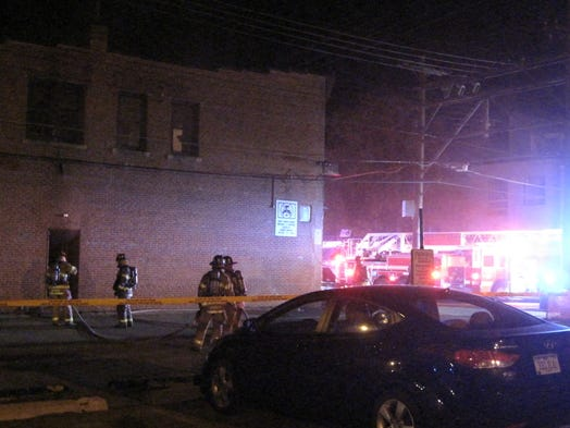 Iowa City firefighters work to put out a fire inside the Hamburg Inn No. 2 early Sunday morning in Iowa City.