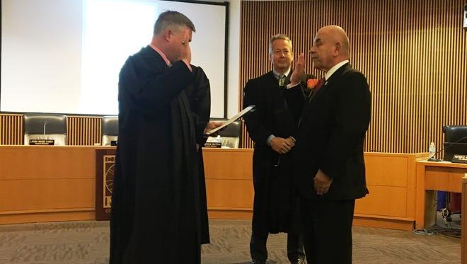Judge David Law of 52-1 District Court swears in Mayor Bob Gatt.