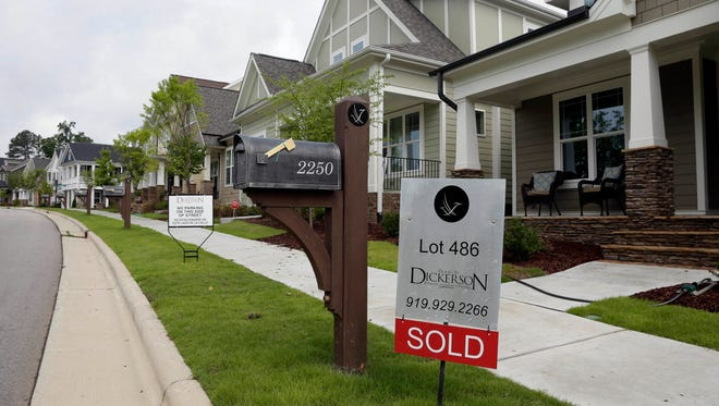 "A ""Sold"" sign is displayed in the yard of a newly-constructed home in the Briar Chapel community in Chapel Hill, N.C. Recent changes in how a buyer's credit rating is calculated could affect the mortgage rate they get when buying a home."