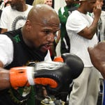 WBC/WBA welterweight champion Floyd Mayweather Jr. works out at the Mayweather Boxing Club on April 14, 2015 in Las Vegas, Nevada. Mayweather will face WBO welterweight champion Manny Pacquiao in a unification bout on May 2, 2015 in Las Vegas.