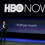 An Apple TV set-top box and TV showing HBO Now.