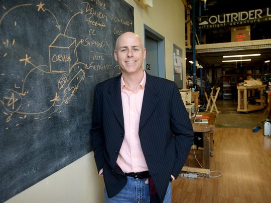 "Tom Ryan, the Kauffman Foundation entrepreneur in Residence, at Outrider USA in Fletcher, one of the start-ups he helps to mentor, on Thursday. Ryan said his position, which keeps him mobile, is to give high-growth local entrepreneurs ""one-on-one coaching and mentoring."""