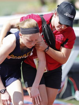 Elise Large of Ozaukee High School finishes first in the D3 3200 meter run on the final day of the WIAA state track and field meet at UW-La Crosse Veterans Memorial Field Sports Complex Saturday, Jun. 3, 2017, in La Crosse