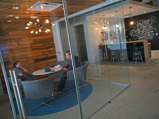 Small conference rooms for employees to innovate at the Archer Group, a fast-paced, full-scale ad agency in downtown Wilmington. Outside is a coffee refreshment bar for employees to enjoy throughout the day.