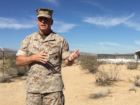 From left, Col. James F. Harp, chief of staff at Marine Corps Air Ground Combat Center, Twentynine Palms, talks about the base's Desert Tortoise Headstart Program on Wednesday, Sept. 30, 2015. Also pictured is Lt. Col. Tim Pochop, director, Natural Resources and Environmental Affairs.
