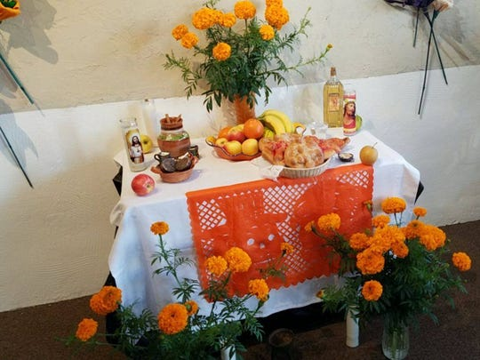 Altar arranged by Rosa Campos, a part of Dia de los Muertos themed art currently on exhibit at White Oak Gallery on Main St., Silverton.
