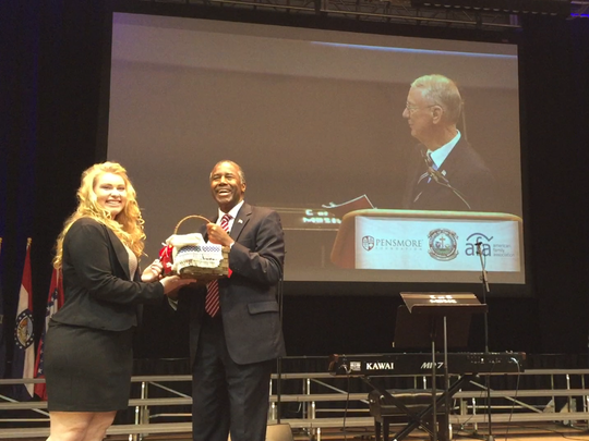 Ben Carson, neurosurgeon and former Republican presidential candidate, accepts a gift basket after speaking about the importance of religious liberty at the College of the Ozarks during the Pensmore National Symposium on Religious Liberty on Friday, Oct. 7, 2016 in Point Lookout, Mo.