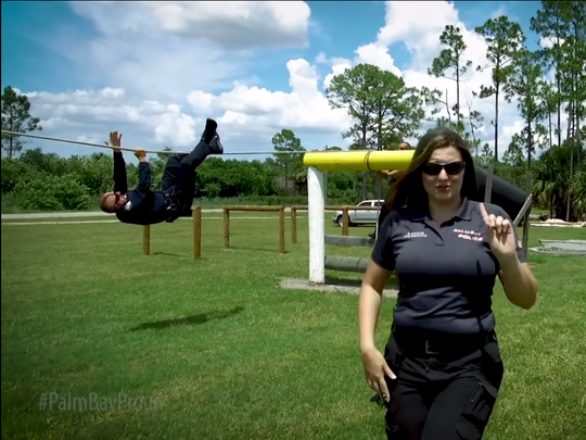 Palm Bay Police crime scene technician Bridget Eakins lip-syncs to Meghan Trainor for the department's video, following the lead of dozens of law enforcement agencies nationwide.
