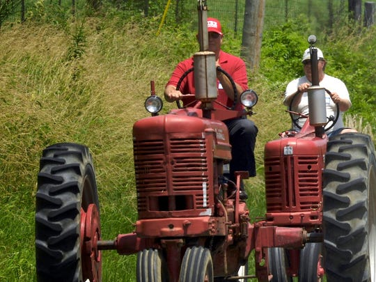 More than 60 vintage tractors make their way toward Niagara along Ky 416 Sunday for the Shake, Rattle & Roll tractor parade. Proceeds from the parade are donated to the American Cancer Society's Relay for Life. (Gleaner photo by Mike Lawrence • 831-8346 or mlawrence@thegleaner.com) 06/29/2008