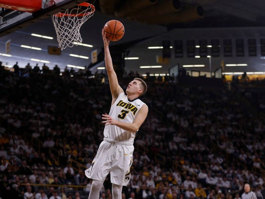 Iowa sophomore Jordan Bohannon lays up a shot against