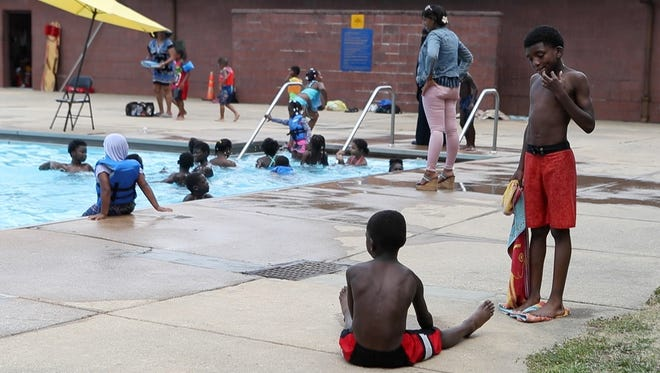 Kids play at Dr. Foster M. Brown Pool Thursday, July 12, 2018 in Wilmington.