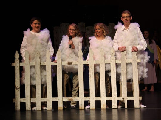 Christian Cambron, Anissa Conley, Hannah Thomas, and Kaleb Nelson perform as the sheep of the village.