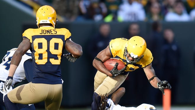Green Bay Packers wide receiver Ty Montgomery (88) is tackled by San Diego Chargers strong safety Jahleel Addae (37) after making a catch at Lambeau Field October 18, 2015.  Montgomery was injured on the play.