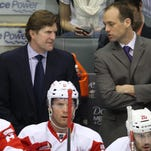 Former Red Wings coach Mike Babcock, left, talks on the bench with former assistant Jeff Blashill during the 2012 season. Blashill, now the head coach of Detroit's top minor league affiliate in Grand Rapids, is the top candidate to replace Babcock, who agreed on Wednesday to take over the Toronto Maple Leafs.