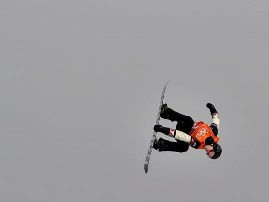 Max Parrot, of Canada, jumps during the men's slopestyle qualifying at Phoenix Snow Park at the 2018 Winter Olympics in Pyeongchang, South Korea, Saturday, Feb. 10, 2018. (AP Photo/Gregory Bull)