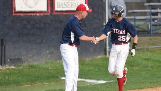 Ketcham's Head Coach Pat Mealy congratulating Matt Seidner on his home run during Tuesday's game versus John Jay.